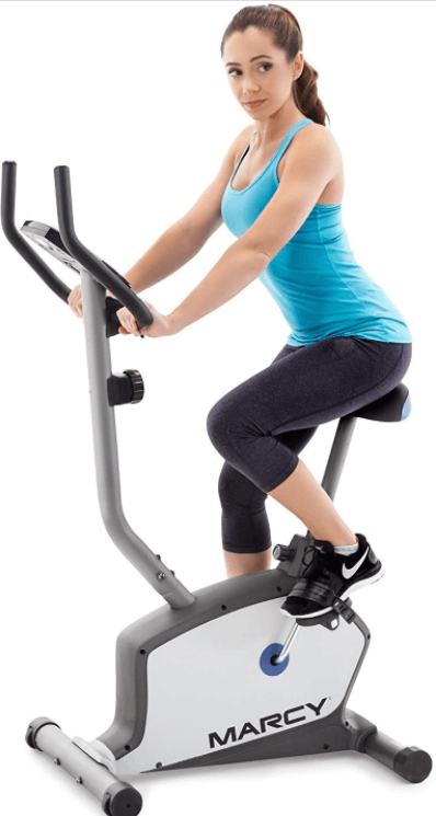 A woman using an Upright Exercise Bike