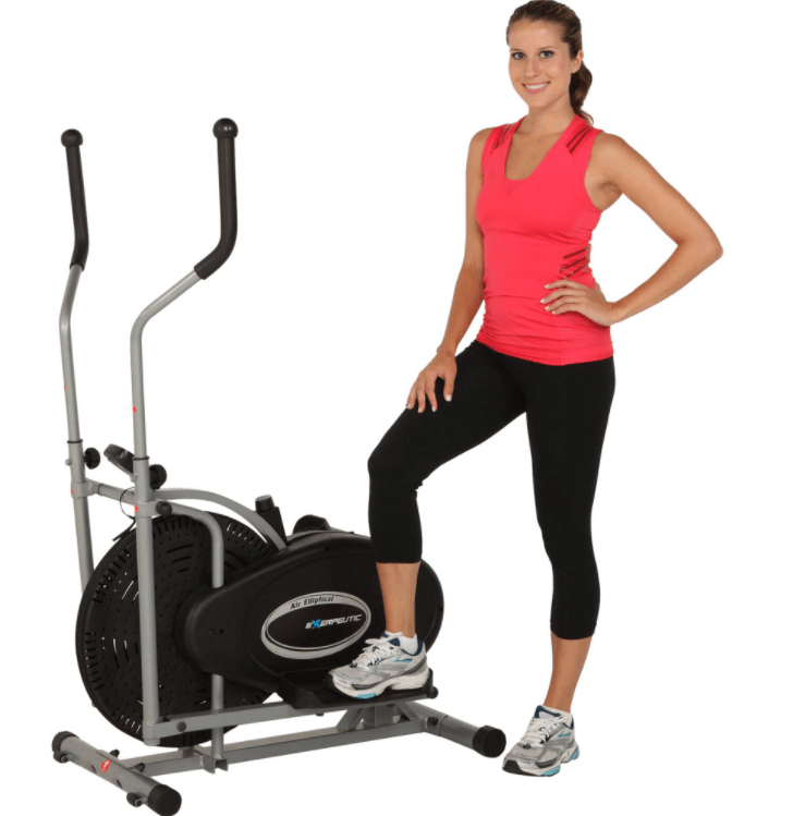 A young woman standing next to an elliptical