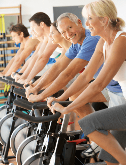 Seniors using exercise bikes