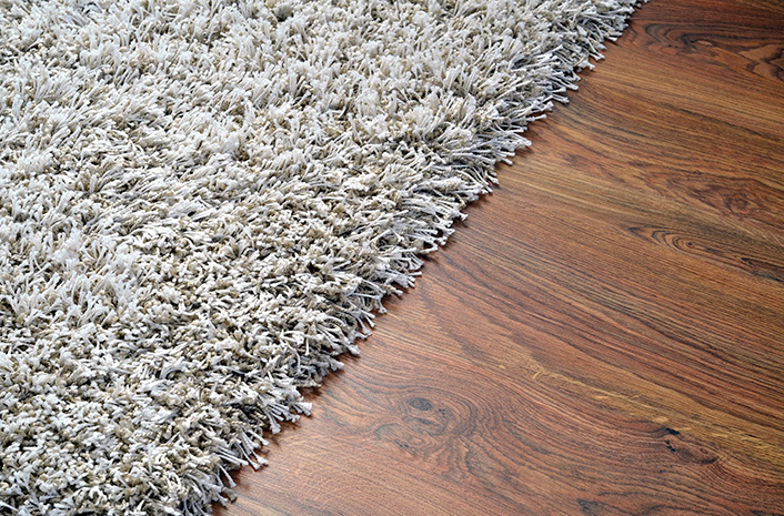A carpet floor is great for cushioning and comfort, although it collects dirt and grime