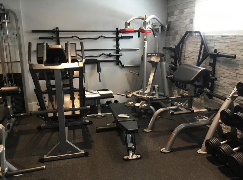 Storing your items in a small gym space takes some creativity